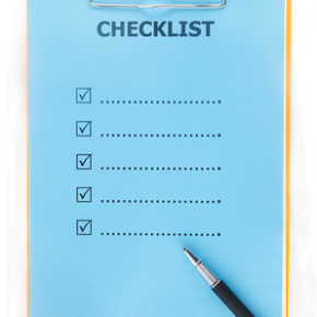 checklist paper with pen on clipboard isolate on white