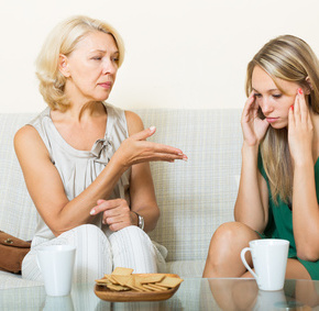 mother with   daughter having serious conversation