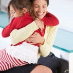 Daughter Greets Mother On Return From Work