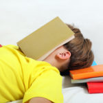 Teenager sleep with a Books