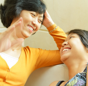 Ethnic mother happy talking with teenage daughter