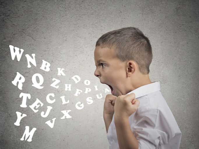 A young child angrily yelling with his fists up and letters coming out of his mouth showing ADHD and defiance