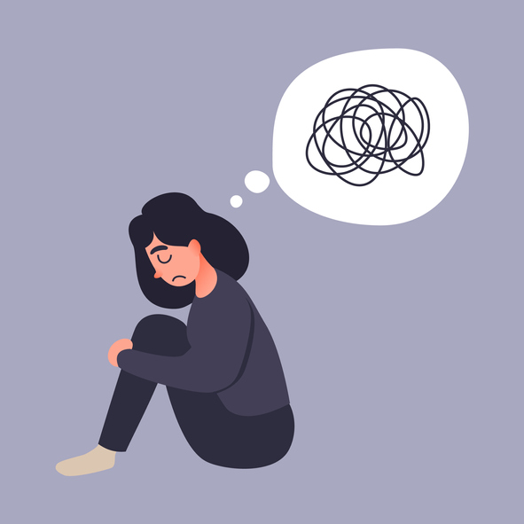 A cartoon of a neurodiverse girl with ADHD frowning sitting holding her knees with a thought bubble with a scribbled lines in it.