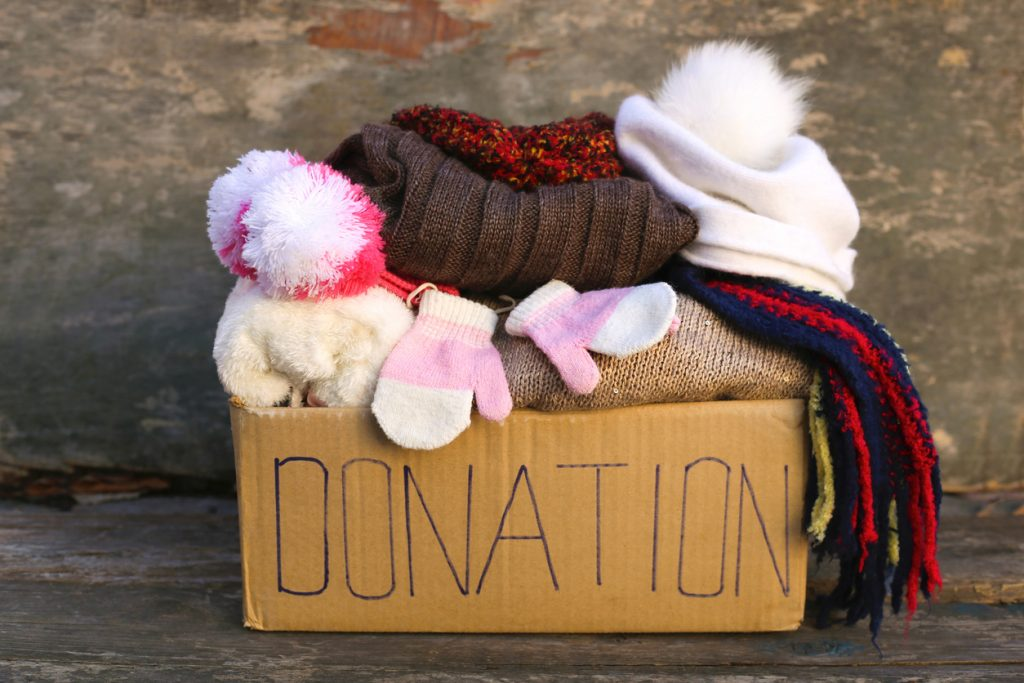 Donation box filled with clothes after spring cleaning