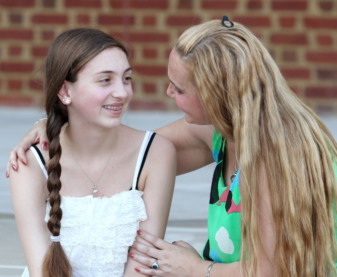 A mother consoling her teen with ADHD and praising her neurodiverse strengths and differences