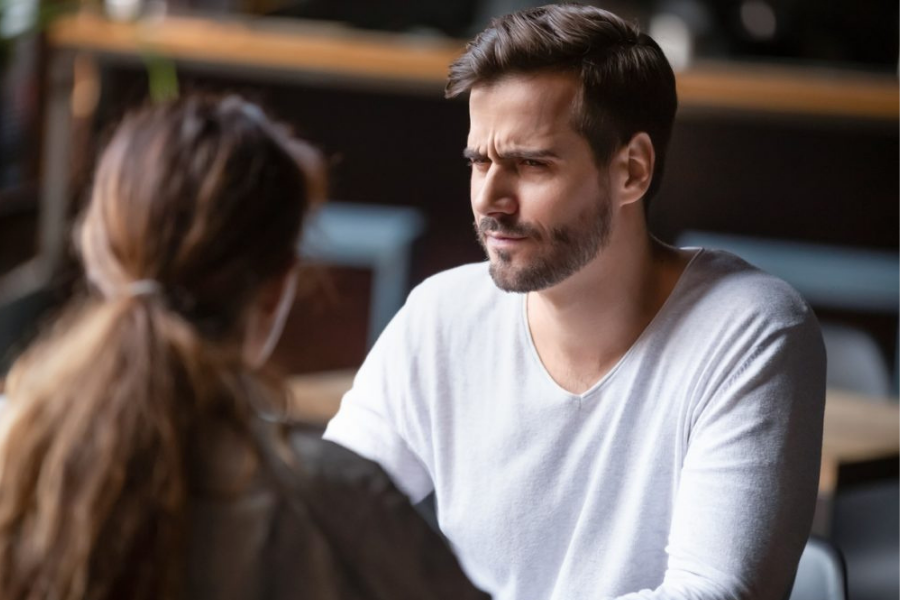 ADHD doubter giving a doubtful look to someone who is discussing ADHD with them.