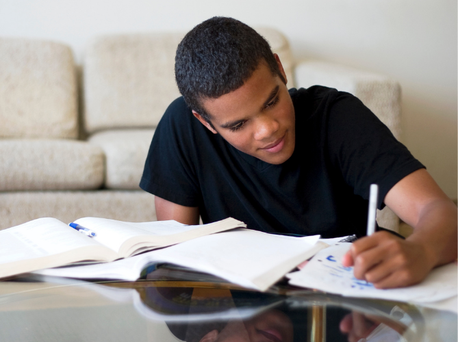 Teen boy with ADHD completing his homework