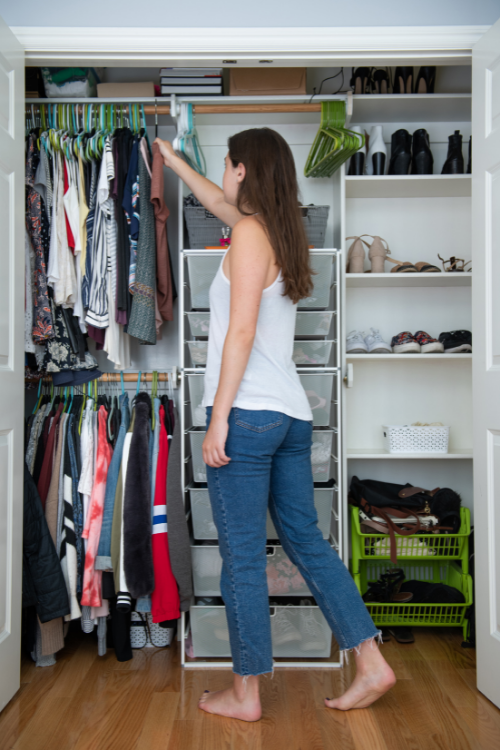 Teen girl with ADHD organizing her bedroom closet.