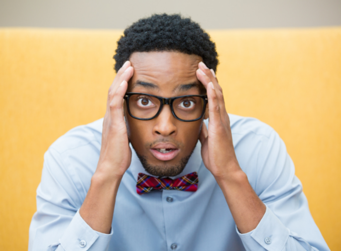 man looking holding his hands to his head and looking in disbelief about ADHD misconceptions someone is sharing with him