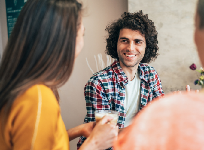 person with ADHD and social anxiety smiling and socializing with two friends