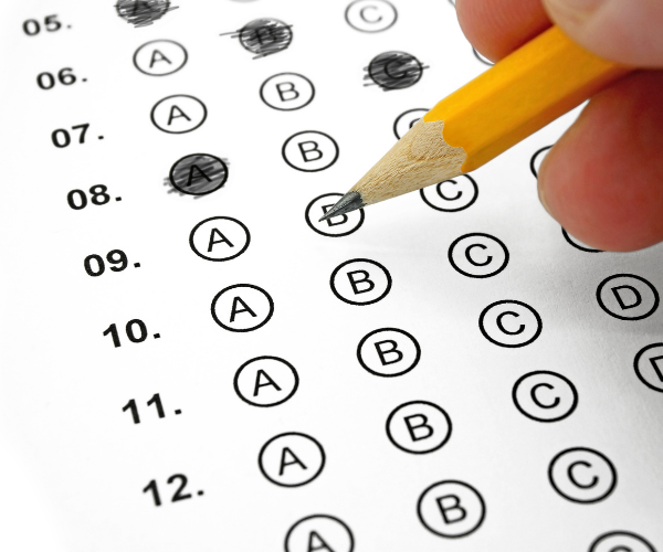 test paper with a pencil filling in circles for answer A, B, C or D.